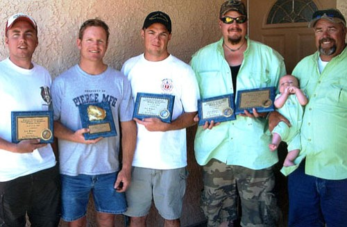 DON MARTIN/For the Miner<br><br> These are the winners of the 2008 United Professional Fire Fighters fishing tournament at Lake Mead. From left are the team that won the striper division, William Nelson, Dan Winder and Robert Borker and Joe Dalmolin and Fred Proudfoot, who is holding the third member of the team, Jake Dalmolin. The older Dalmolin and Proudfoot won the largemouth bass division.