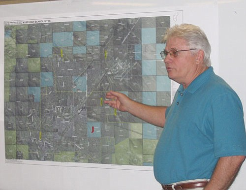 TERRY ORGAN/Miner<br><br> Oz Enderby, Kingman Unified School District director of construction, points to sites on a map under consideration for construction of a new high school. He spoke during a workshop of the district governing board Wednesday.