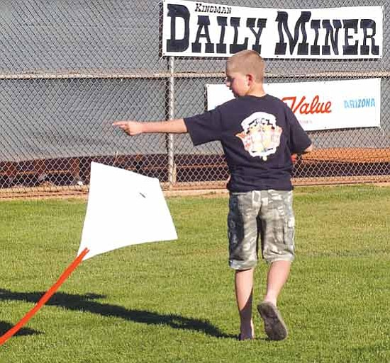 JC AMBERLYN/Miner<br> The 18th annual Kite Flying Extravaganza will be held at Centennial Park Tuesday afternoon. Here, Max Gibbons takes his kite out for a flying session during last year's event.