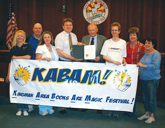 From left to right are Trish Cobbs from MCL, Brent Potter from KHS, Kathy McGehee of MCL, Robert Shupe of MCL, Mayor Les Byram, Bruce Carter of MCL, Barbara Patterson of MCL and Lisa Winebrenner of KHS.