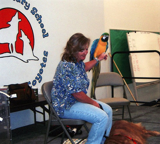Courtesy<br> Brenda Muncy recently visited Yucca Elementary School with her dog, Noah, and her parrot, Schrimshaw.