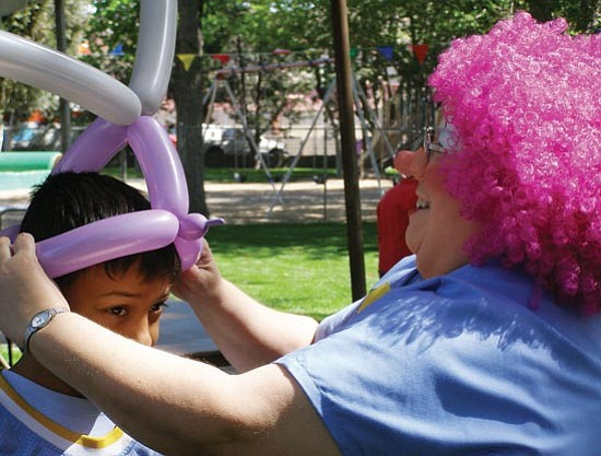 Courtesy<br><br> Silly Dilly the clown fits a balloon to a boy�s head during the 2007 KABAM festival.