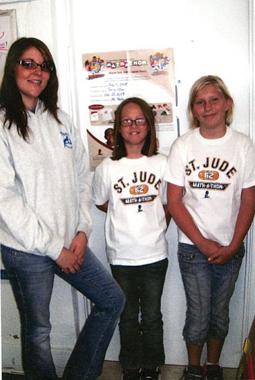 Courtesy<br> From left, Kayla Childs (teachers aide) at Yucca Elementary School congratulates Dawn Dorris and Amber Curry on being the high fundraisers for the St. Jude Math-a-thon recently.