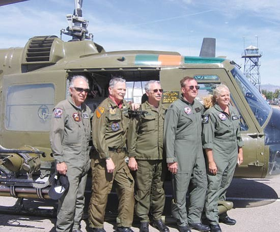 TERRY ORGAN/Miner<br><br> Members of the flight crew of a Vietnam-era Huey helicopter take a moment for a photo Thursday after refueling at the Kingman Airport before resuming their journey to Washington, D.C., as part of a Flying Thunder group that will meet up with motorcyclists at the Vietnam Veterans Memorial Wall. From left are Van Ferry, Lou Rochat, Randy Zahn, Carl Allen and Shayne Meder.
