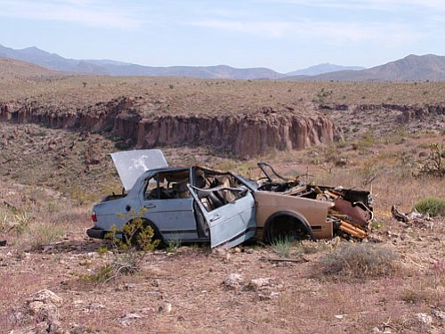 Greag Meriwether/Courtesy<br><br> An abandoned stripped car lies rusting on Arizona state land just south of Kingman city limits.