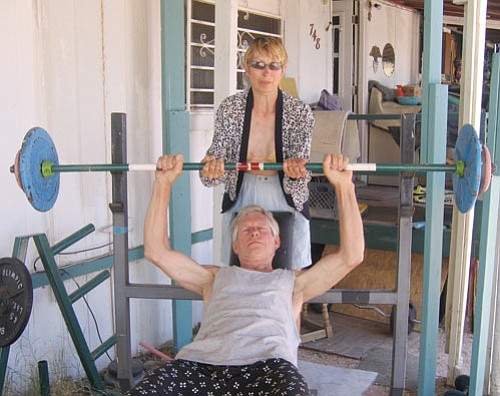 TERRY ORGAN/Miner<br><br> Jim Boyles, with his wife, Cynthia, works out at his Golden Valley home.