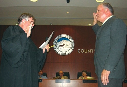NICHOLAS WILBUR/ Miner<br><br> Judge Gary Pope administers the oath of office to the new Mayor John Salem Monday evening in the Mohave County Administration building.