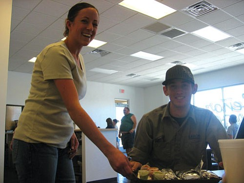 JAMES CHILTON/Miner<br><br> Nikki Barkhurst, daughter of owner Lori Barkhurst, serves bean and cheese burritos and taquitos to Tanner Schritter at Señor Taco Thursday, June 5.
