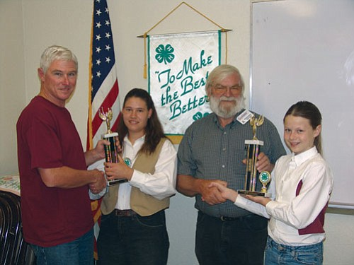 "Courtesy<br><br> Kurt Russell presents the Top Placing Senior Member Award to Brianna Smith of the Cactus Critters 4-H Club for her demonstration ""How to Be a Super Showman."" Howard Noble presents the Top Placing Junior Member Award to Rebekah Russell of Cedar Hills 4-H Club for her demonstration on ""Fillet That Catfish."""