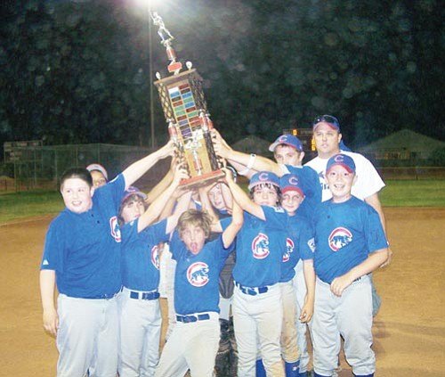 Courtesy<br><br> The City Towing Cubs of Kingman South Little League gather around the championship trophy they won during the District 9 Major Tournament of Champions June 9-12 in Mohave Valley. The Cubs will get their name on the trophy, the first Kingman team to do so since 1989.