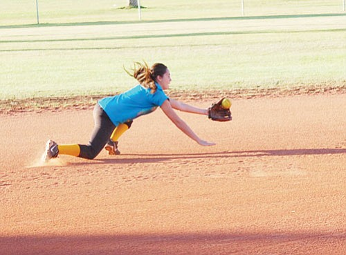 SHAWN BYRNE/Miner<br> Sidewinders' shortstop Jordan Book makes a diving stop during an early morning practice on Saturday. The Sidewinders are gearing for the ASA state championship to be played in Kingman Friday through Sunday at Centennial Park.