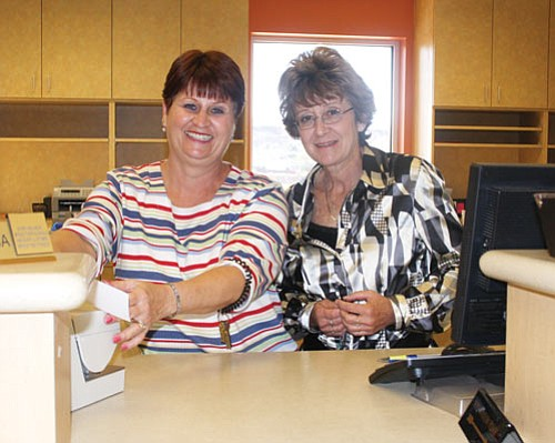 JC AMBERLYN/Miner<br><br> Teesa Harper (left) and Vickii Cook are tellers at Mohave State Bank's newest Kingman location, 2202 Hualapai Mountain Road. Mohave has six locations in Arizona.