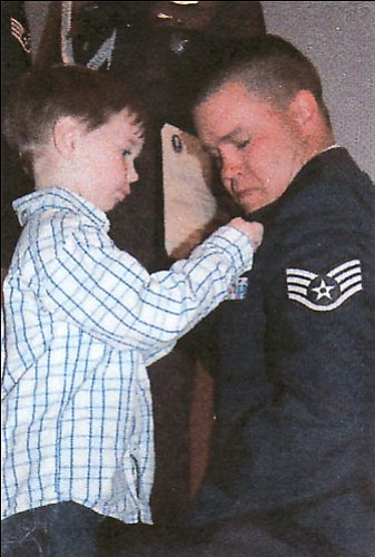 Sgt. Shane Samson is honored to have his wings pinned on by his four-year-old son, Jayce.