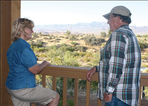 JC AMBERLYN/Miner<br> Tommie (left) and David Upton own and operate Upton's Hidden Pines Bed & Breakfast, which offers guests breathtaking views and quiet solitude.
