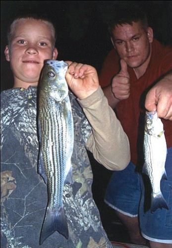 DON MARTIN/ Miner<br><br> Ivan Teskey, 11,  and his cousin Billy Palmisano compare the fish they caught at South Cove on Lake Mead.