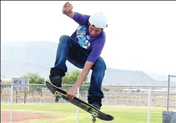 SHAWN BYRNE/Miner<br><br> Forrest Sai soars through the air at the skate park Tuesday.