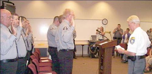 MCSO/Courtesy<br> Mohave County Sheriff Tom Sheahan, right, welcomes 19 more detention officers July 11.