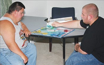 JC AMBERLYN/Miner<br><br> Clinton Gode (left) and Patrick West-Owens play a board game at TLC Wednesday evening.