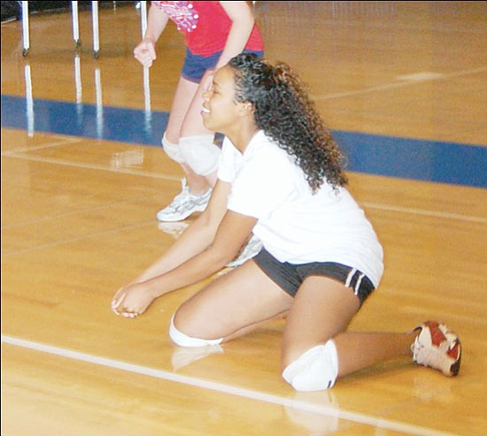 SHAWN BYRNE/Miner <br>Kingman High School's Dominique Hale gets ready for a dig at the Chris Campbell Volleyball Camp on Friday at KHS. Players from KHS as well as middle school players participated in the camp to ready themselves for the upcoming season.