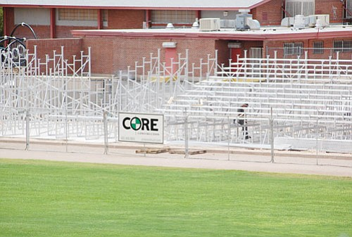 SHAWN BYRNE/Miner<br><br> Core Construction Services of Arizona, Inc. of Phoenix works on the building of new seating at Lee Williams Field on the campus of White Cliffs Middle School. The project is on schedule to be completed for the start of the Kingman Bulldogs football season.