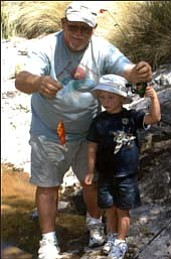 First fish! Outdoor writer Don Martin is all smiles as his 6-year-old grandson, Logan, holds his first fish.<br>Courtesy