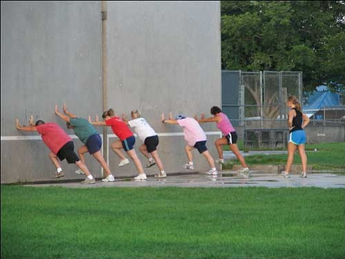 Courtesy<br /><br /><!-- 1upcrlf2 -->Andrea Ott (right) has six Fit Campers up against the wall as they exercise in Centennial Park Thursday morning. The campers are, from left to right: Chris Durkin, Deana Nelson, Leah Ott, Sue McDonnel, Kim Gross and Pattie Paine.