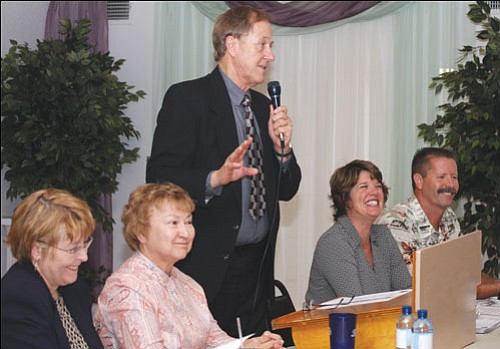 JC AMBERLYN/Miner<br> Richard Basinger (standing) introduces guest speakers Tuesday night at the Elks Lodge during a Mohave County Republican Forum. Seated from left to right are state representative candidate Doris Goodale, State Representatives Nancy McLain and Trish Groe, and State Senator Ron Gould.
