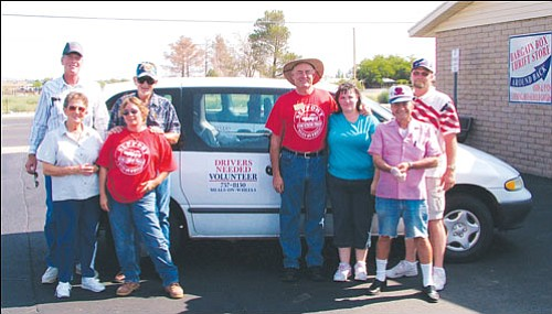 Courtesy<br><br> Shown here from left to right, Kingman Elks Lodge No. 468 Past Exalted Ruler Gary Watson, volunteer driver Bonnie Wolf, case worker for The Foundation for Senior Living Stephanie Polk, volunteer driver Larry Price, Kingman Elk and Mohave County Treasurer Lee Fabrizio, Kingman Senior Nutrition Worker Angie High, volunteer driver Rich Libertini and soon-to-be Kingman Elk and Mohave County Public Defender Dana Hlavac, take a break prior to loading up the Meals on Wheels vans and heading out to deliver food to the needy.  More than 363 meals are delivered daily to needy residents, and another 350 meals are served at the four nutrition centers operated by the Mohave County Department of Public Health and supported by Kingman Elks Lodge No. 468 members.