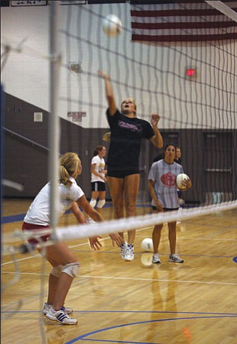 JC AMBERLYN/Miner<br><br> Lindsey Reed goes up for a kill during the Bulldogs' practice on Aug. 15 at Kingman High.