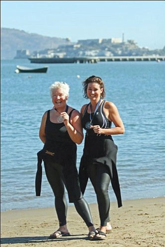 "LESLIE MARTIN/Courtesy<br><br> Leslie Martina and Ellen Boyer were two of four Kingman residents who swam the Alcatraz 100 ""Swim with the Champions"" race in San Francisco. Matt Hoyng and Russ Eidman also swam the race."