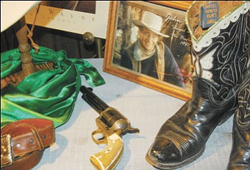 "Patrick Whitehurst/Williams-Grand Canyon News<br><br> John Wayne's pistol from ""The Shootist"" is on display at Wild West Junction."