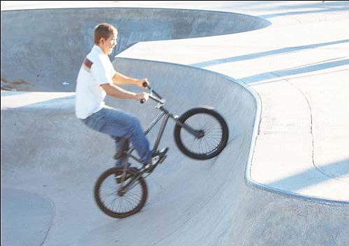 Dakota Ferrier rides out of a bowl at the skate park in Firefighters Memorial Park. He could be ticketed in the future, and he should be wearing a helmet.<br>SHAWN BYRNE/Miner