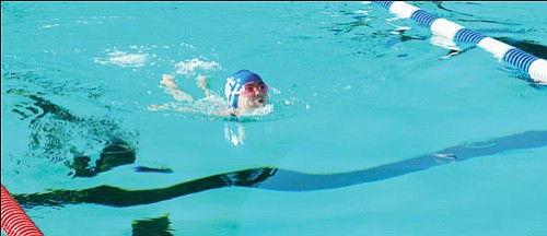 SHAWN BYRNE/Miner<br><br> Shelia Ramirez of the Kingman Dolphins swims the breaststroke during the girls 8-and-under 100-yard individual medley at the Andy Devine Days Invitational on Saturday. Ramirez scored 11 points for the Dolphins in the two-day meet.