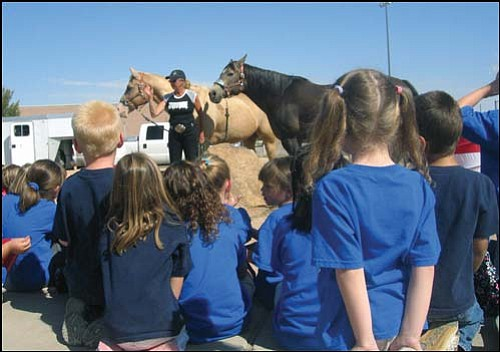 Women�s Professional Rodeo Association cowgirl Dolli Lautaret speaks to Hualapai Elementary kindergartners on Friday in advance of the Andy Devine Days Rodeo.<br>AARON ROYSTER/Miner