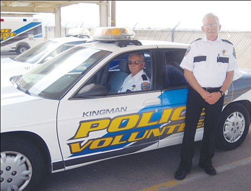 SUZANNE ADAMS/ Miner<br><br> Wayne Harden (inside) and Ray Turner both are volunteers in the Kingman Police Departments Volunteers In Policing program. They are two of the 11 residents who volunteer their time to patrol Kingman�s streets looking for parking violations and suspicious activity.