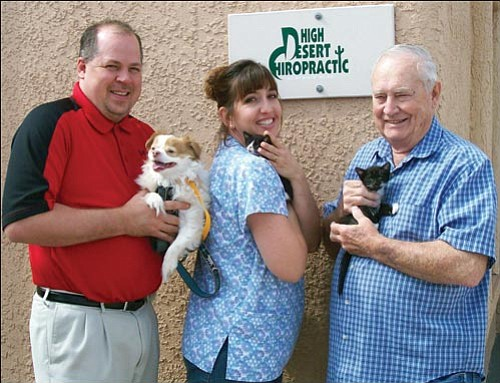 Courtesy<br><br> From left, Dr. Rob Thornton and his wife, Kim, and his father, Bill Thornton, with animals that are available for adoption at the animal shelter in Kingman at 950 Buchanan St.