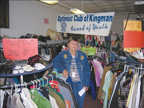 JAMES CHILTON/Miner<br><br> Marlene Tidwell, the president of the St. Mary's conference for St. Vincent de Paul Catholic Church, stands in a section of the church's thrift store at 218 Beale St. Monday morning. Using the proceeds from the thrift store's clothing and appliance sales, St. Vincent's was able to assist nearly 3,800 people with food, clothing, prescriptions and utility payments last year alone.