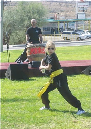 SUZANNE ADAMS/Miner<br> Here's one girl you don't want to make angry. Christina Tatalovic shows off her skill with a sword during a fall event at Locomotive Park. Tatalovic is a student at the Traditional Hung Gar Academy of Kingman, one of many martial arts schools in the area which offer classes for children.