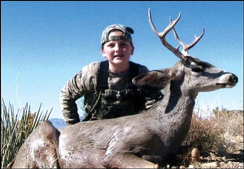 """Courtesy Don Martin<br> Theresa """"Ty"""" Rogers of Kingman shows the 3-by-3 buck that she bagged on a recent juniors-only deer hunt in the Hualapai Mountains. The buck was the first mule deer for the young hunter."""
