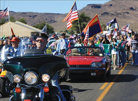 JC AMBERLYN/Miner<br><br> Crowds gathered on Northern Avenue Saturday morning for the 5th Annual Mohave County Veteran's Day Parade, which was organized and sponsored by VFW Post 10386.