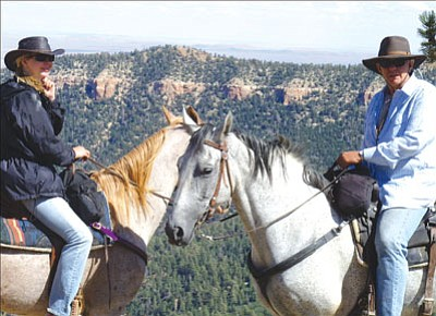 Courtesy<br><br> Molly Johnson and her former stepfather, Dr. Ken Jackson, sit atop of their horses north of the Grand Canyon during their trip on the Arizona Trail.
