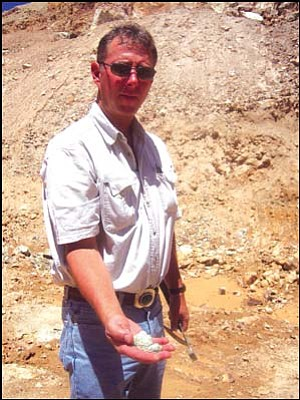 Buried treasure: Marty Colbaugh is the third generation of his family to run Colbaugh Processing in So-Hi Estates, Golden Valley. The company mines some of the highest-quality turquoise in the world. Here, he holds raw turquoise he has just dug from the side of a mountain.