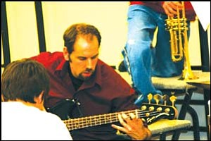 All that jazz: Mike Schreiber is the music program director at Black Mountain School. Here, he demonstrates a few bars of music for his eager students. Schreiber has initiated a jazz program at the school to prepare students for jazz band at the high school level. GVG Photo Courtesy of David Rivedal