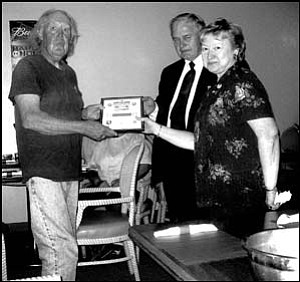 The newly established Golden Valley Republicans Club hosted its kickoff dinner on March 17 at KC's Restaurant in Golden Valley. Special guest was state Rep. Nancy McLain, R-Bullhead City (right). Here, she and Republican Party Chairman for District 2 Lou Tranka (middle) present a charter member certificate to the club's first member, Vernon Williams.