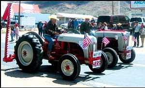 Veterans 'n'n tractors: The Dolan Springs Am Vets Post 3 hosted its first-ever antique show in conjuction with the VFW Loyalty Days parade on May 5. Shown here are two of the winning entries in the show, which had nine total entries. GVG Photos/DONNA NEWMAN