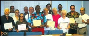 In appreciation: The Incorporate Golden Valley Board of Directors gave out certificates of appreciation to all of the volunteers who donated their time and efforts to gather signatures on petitions. Here, from left to right, are IGV board member Dennis Emery, volunteers Robert Standley, Amber Celeya, Juanita Celeya and Ralph Eaton, IGV Treasurer Gordon Hoover, Chairman Henry Peairs Jr., Bob Wolf, Luca Zanna, Shirley Wolf, IGV petition sub-committee Chairman Randy Cone, volunteers Peggy Cone and Harry Drew, and IGV board member Daniel Richardson. GVG Photo/DONNA NEWMAN
