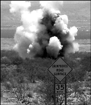 TNT:  Mohave County Sheriff's deputies located explosives inside a vehicle last Wednesday morning and closed Shinarump Drive while they detonated the dynamite. Deputies found an abandonded Oldsmobile Cutlass and an inspection of the vehicle turned up sticks of dynamite in a plastic bag. The photo at right is the explosives being detonated in the desert. Submitted