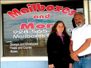 800 boxes: Cindy Smith and Henry Deeter provide mail delivery service at their store on Highway 68.