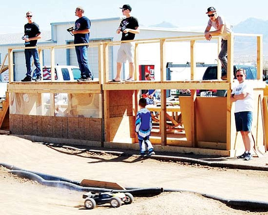 Submitted<br> On your marks: Andy Lewis of Kingman has brought the thrill and competition of remote-controlled racing back to the Kingman area. Here,  participants race their cars at RC Raceway,  4455 N. Bank St.