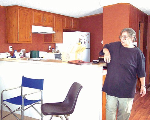 Submitted<br><br> New home: Norma Rupert of Dolan Sorings is the first owner of a new replacement mobile home provided by Mohave County for residents who are elderly or disabled. The county had considered repairing Rupert's old 1973 mobile home, but discovered it was just as cost effective to buy a new one for $40,000, as opposed to spending $37,000 to fix up the old one. The program is grant funded.
